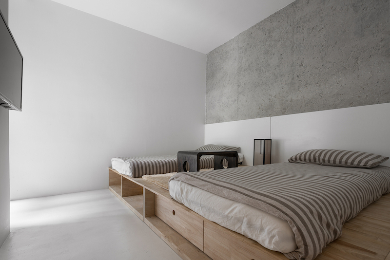 The sleeping area is a group of two beds which share the same base platform. There's built-in storage underneath