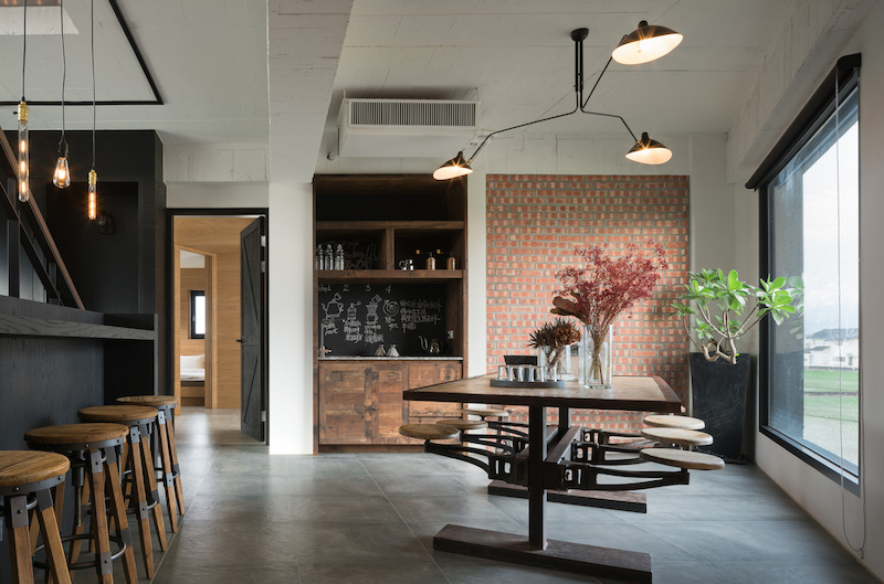 The materials used throughout the interior are simple and raw for the most part, including concrete, brick, wood and metal