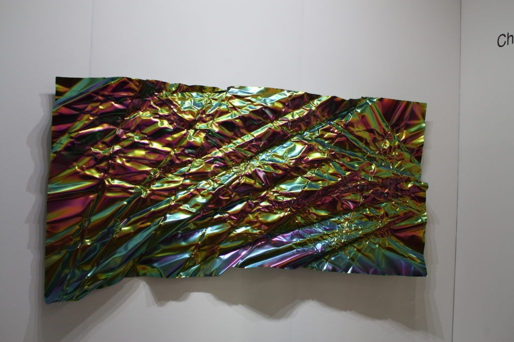 Iridescent colors and a crumpled texture make Prinz's work attractive.