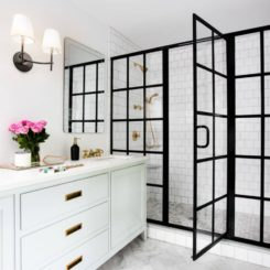Contrasting bathroom with shower black frame and white subway tiles