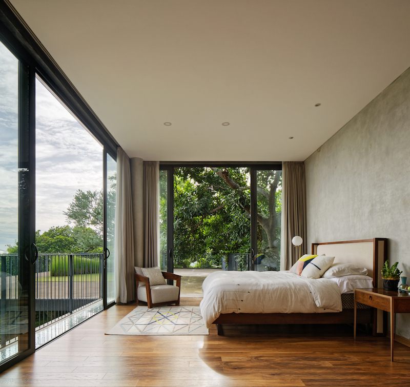 The bedrooms open up to the views as well and have curtains for privacy and shade