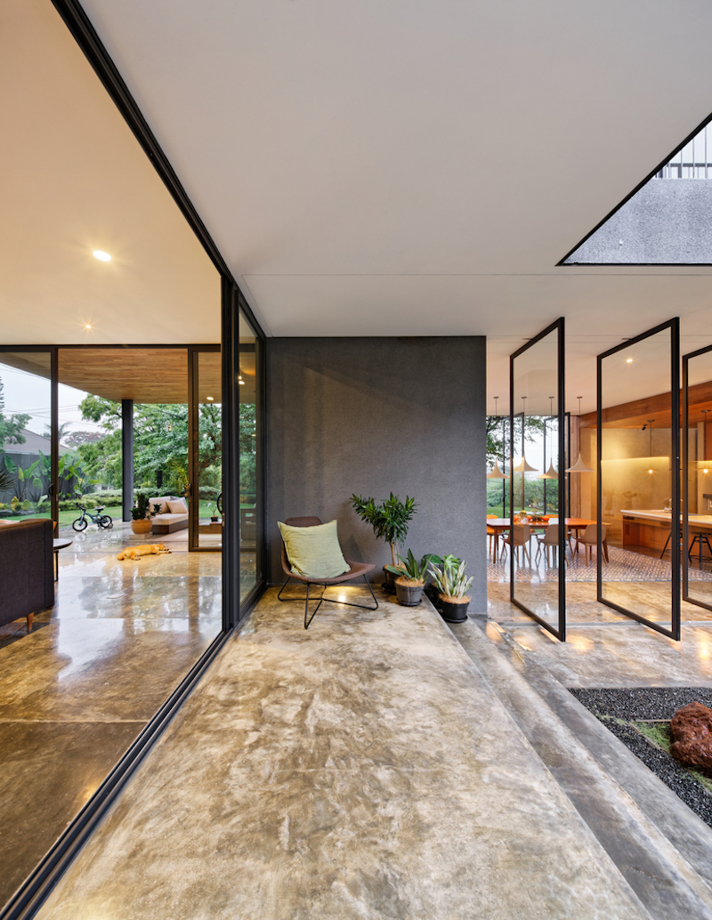 Polished concrete flooring unifies the indoor and outdoor spaces, creating a seamless visual connection between them