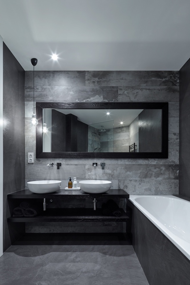 The main bathroom is also dark, being in sync with the bedroom but at the same time looking very chic
