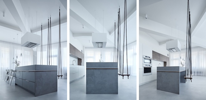 The kitchen island is the highlight of the entire apartment. It doubles as a bar and it also has a dining table extension