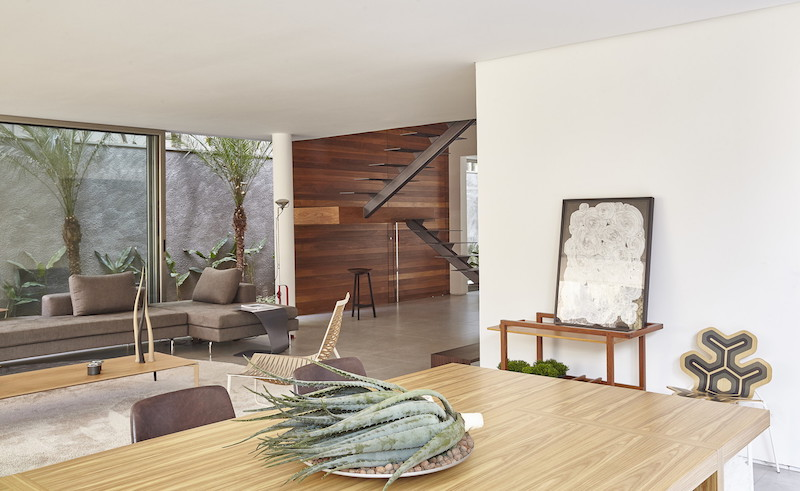 Warm wood elements are beautifully spread throughout the house in various forms. They add elegance and style