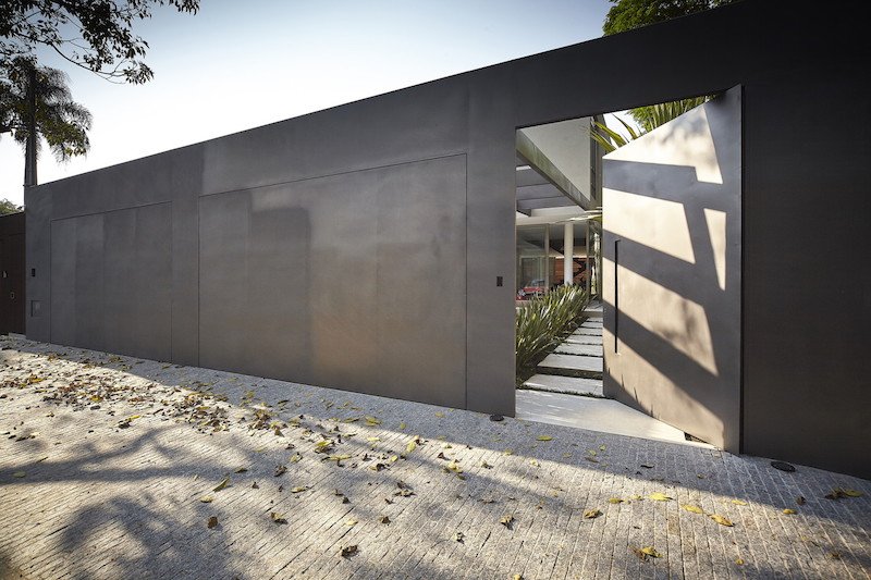 The street-facing section of the site is framed by a tall, solid wall which ensures maximum privacy