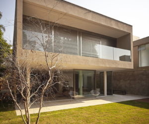 Urban Residence Lets Nature In Through Its Glazed Facades