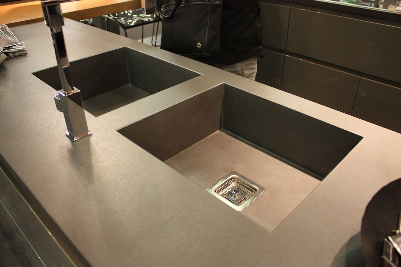 New materials and integrated sinks easily update a kitchen space.