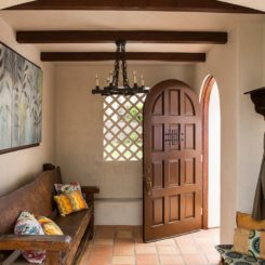Small entryway with rustic bench and travetine floor tiles