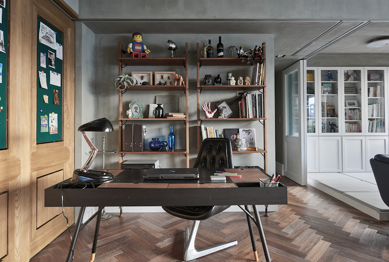 The study area showcases the husband's love for industrial design and a more masculine aesthetic