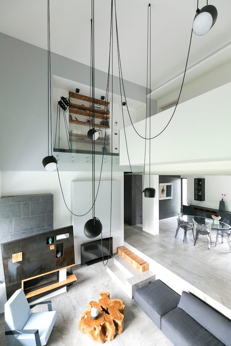 The living area is quite special, featuring a double-height ceiling and a floor level which drops below the ground floor