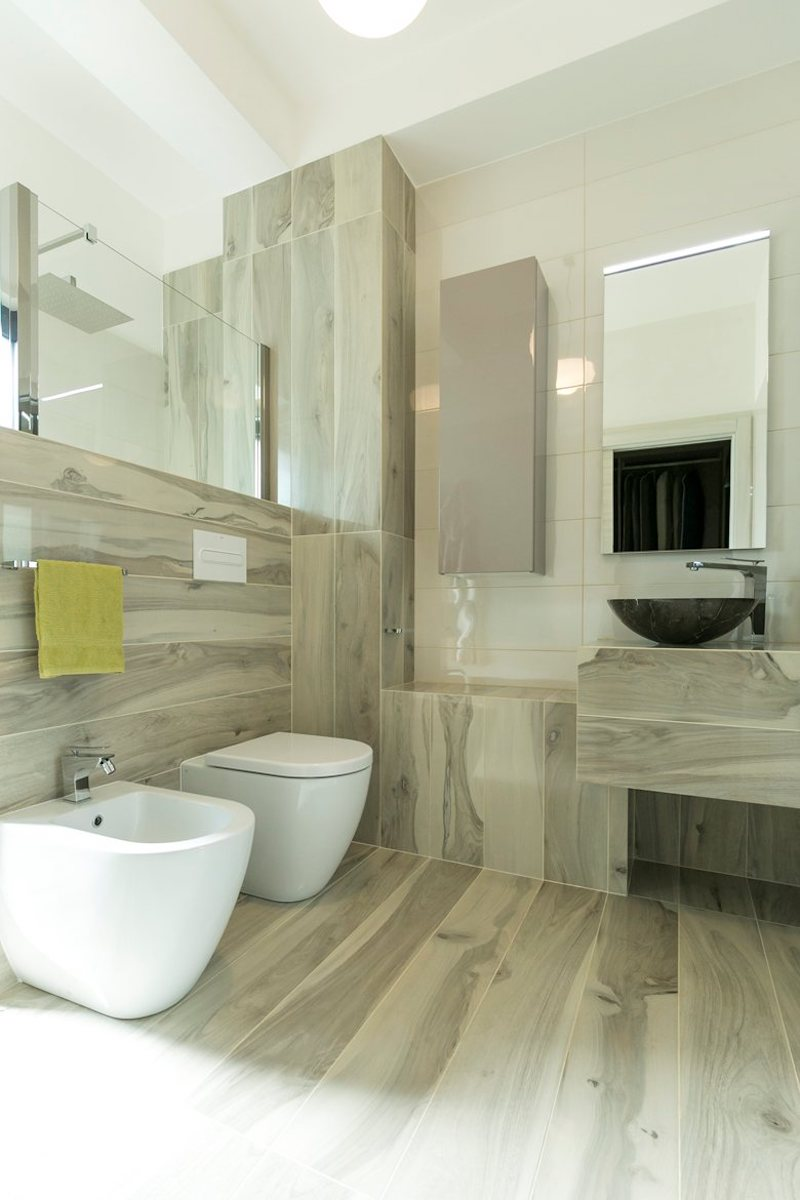 Mirrors mounted on the bathroom walls create the feeling of a larger and brighter space