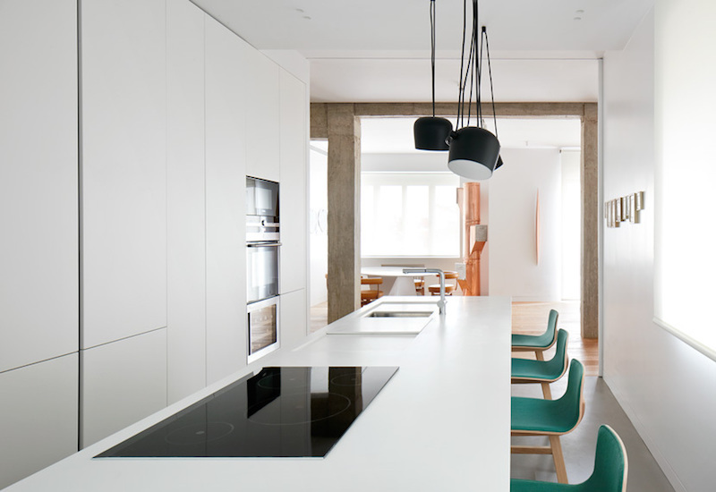 The island sits at the center of the kitchen and serves as a focal point for this space