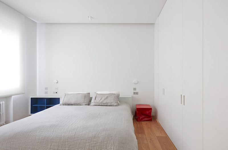 This room has a full-height storage unit which blends in perfectly with the white walls