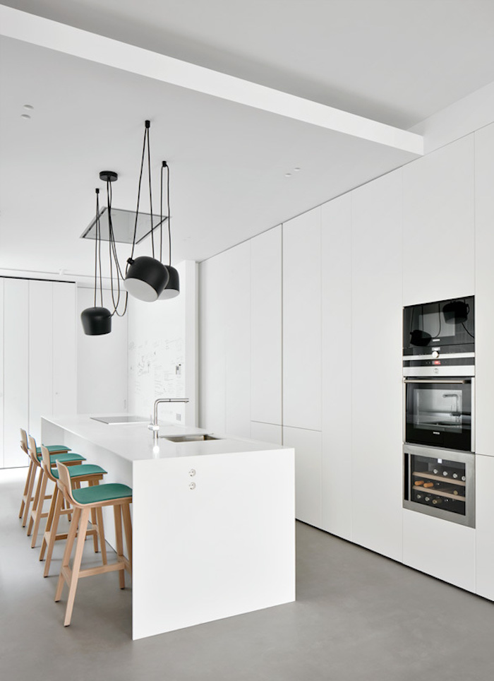 the interior design of the kitchen is very simple, clean and fresh with a few interesting accents