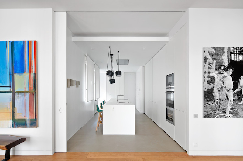 The kitchen occupies a separate space which can either stay open or be closed off with a sliding partition