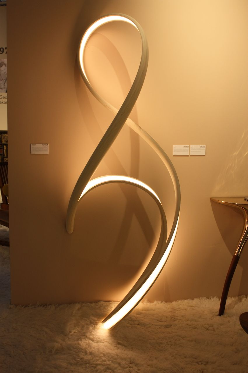 The lamp is made from micro-laminated, cold-pressed bent wood.