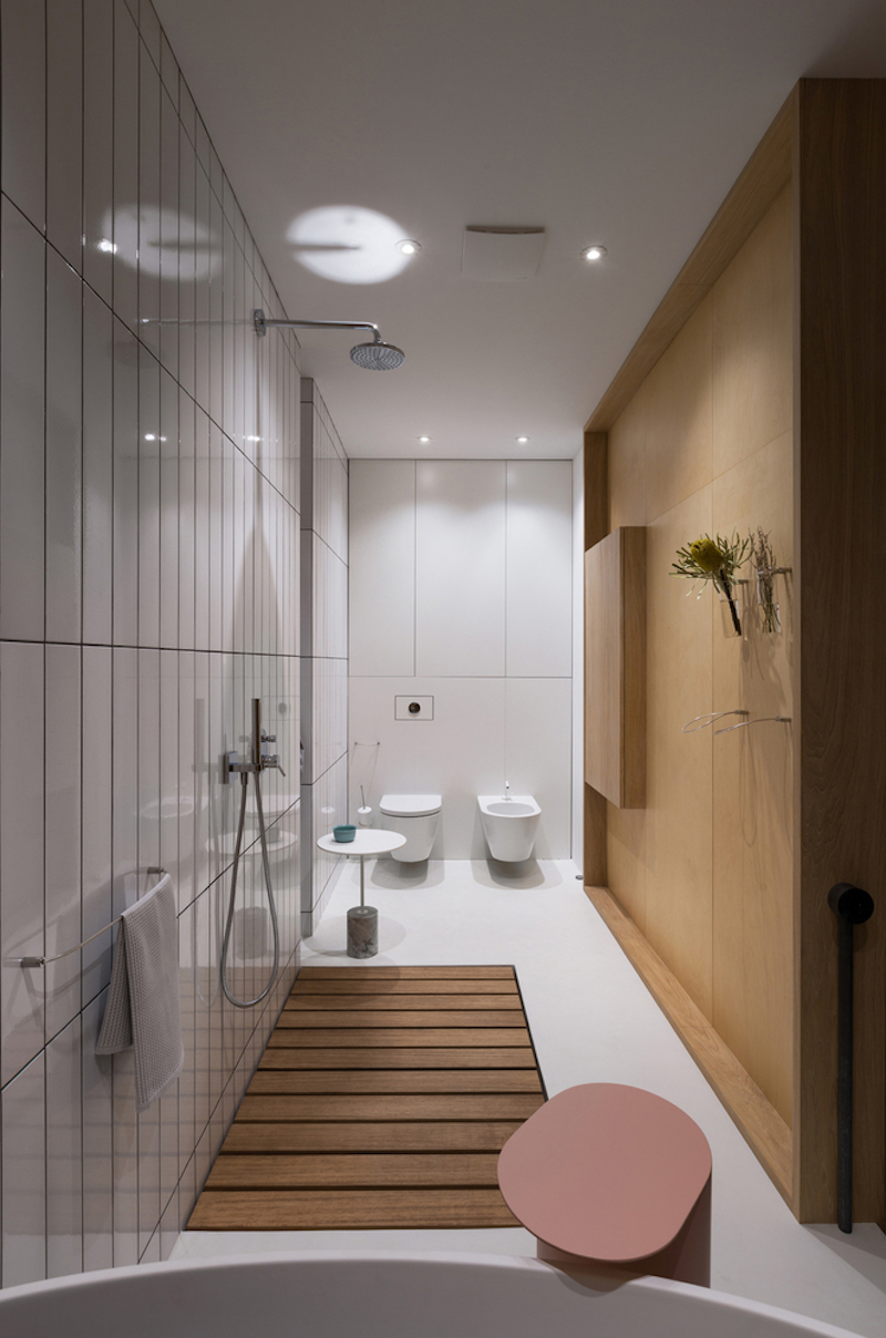 The master bathroom has its own wooden divider which separates it from the wardrobe space