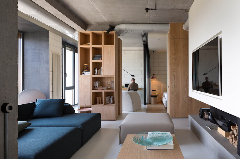 Indoor Garden Apartment An apartment for one gets a complete makeover and an indoor garden the social area is organized into several zones separated through furniture elements or bare concrete dividers workwithnaturefo