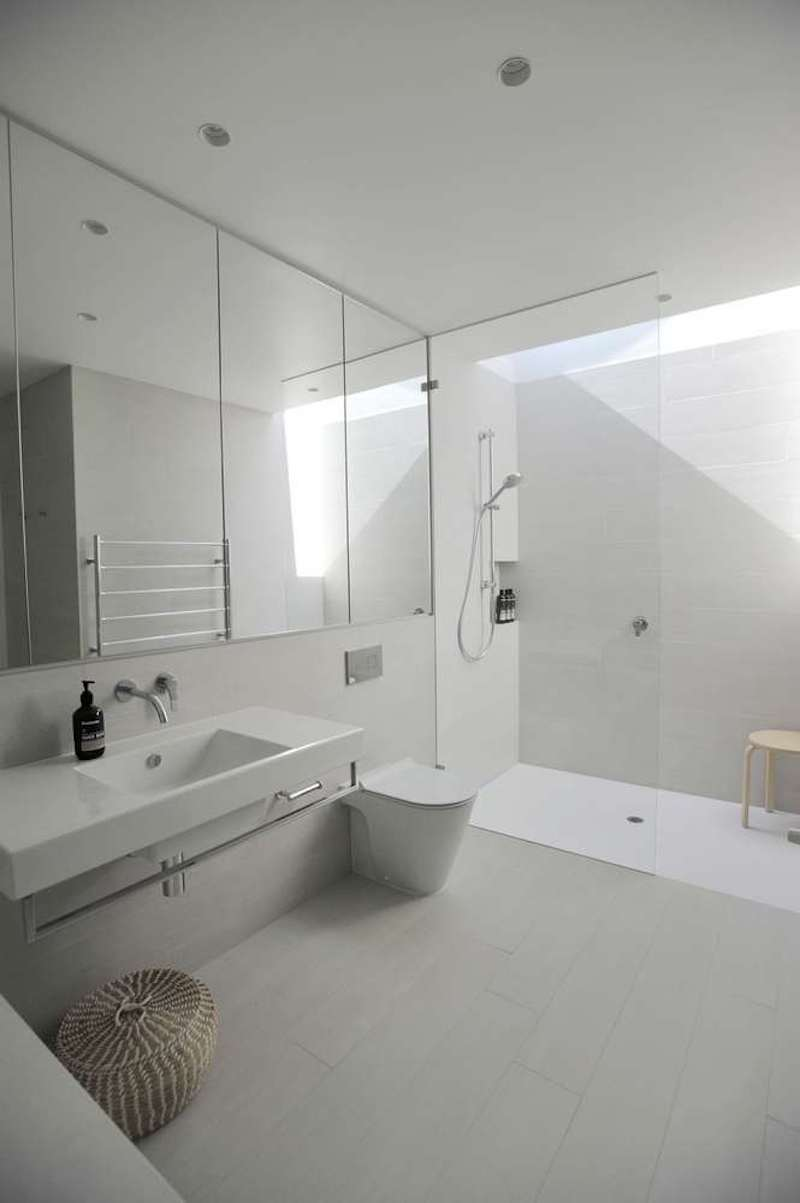 The bathroom has a skylight which brings in light without interfering with the privacy of the space