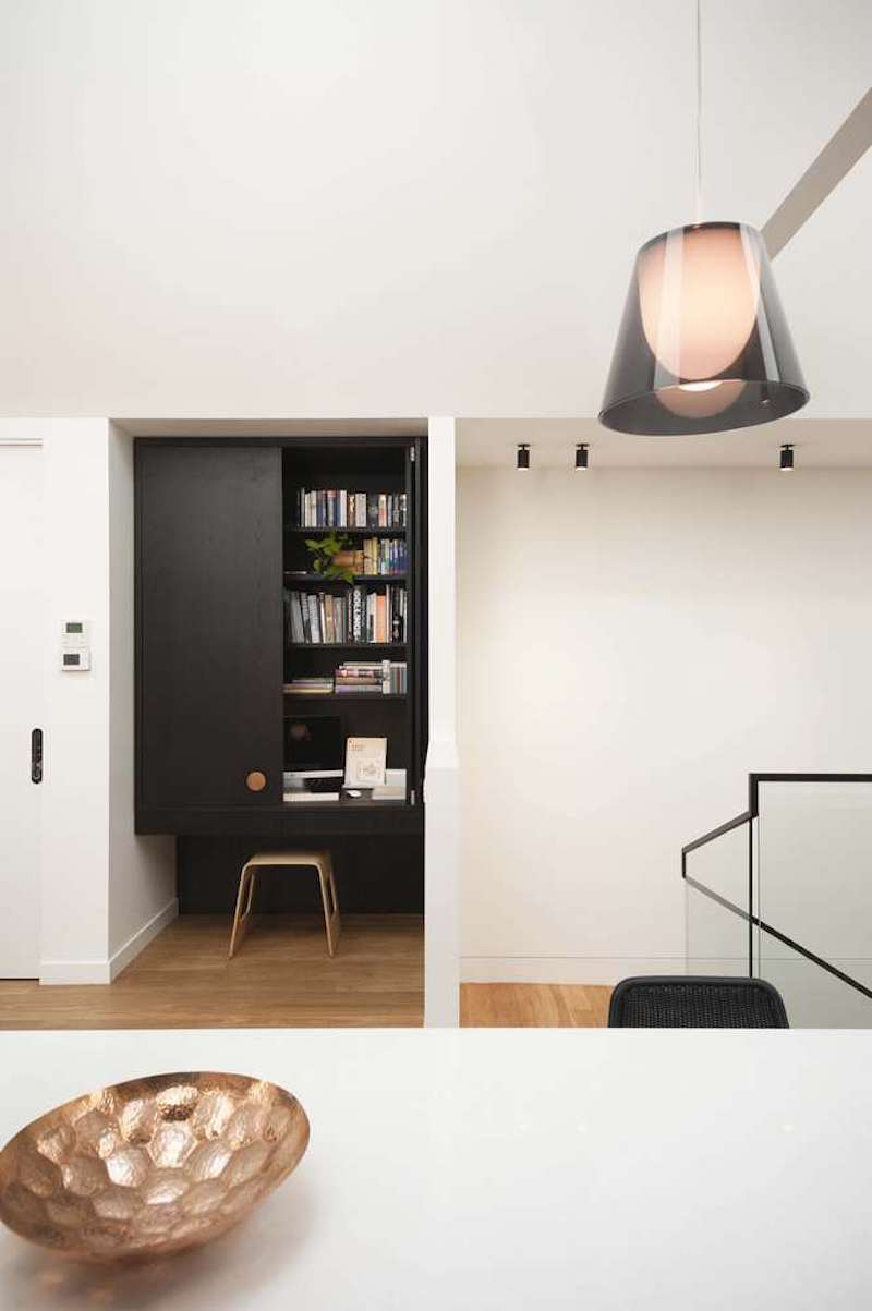 The new interior design also includes a small workspace elegantly concealed in a nook