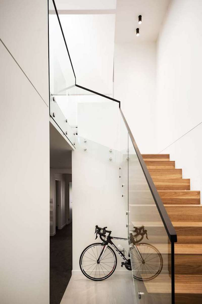 The staircase which connects the two floors has transparent glass railings which let light pass through them