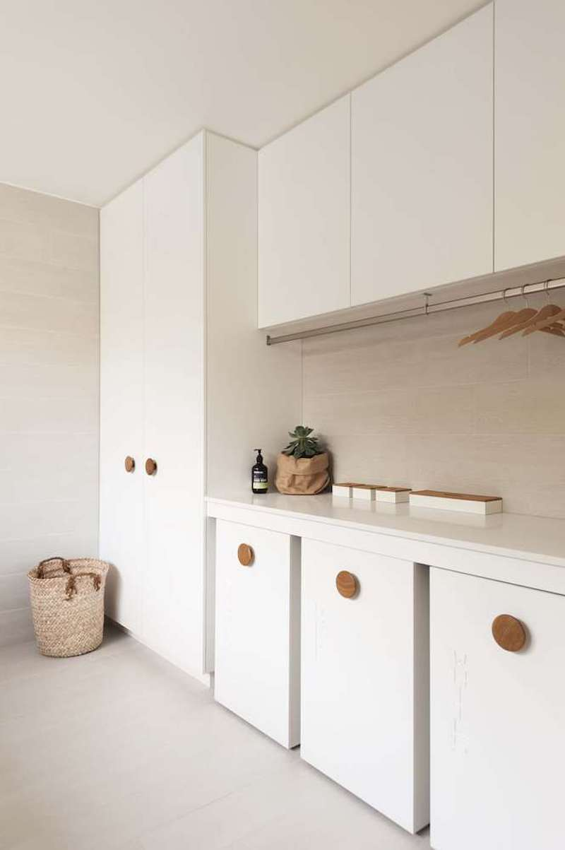The laundry room is very bright, chic and elegant and has a really welcoming decor