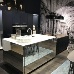 Black kitchen design with mirrored island