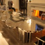 Large and imposing metallic pieces set the tone for a space.