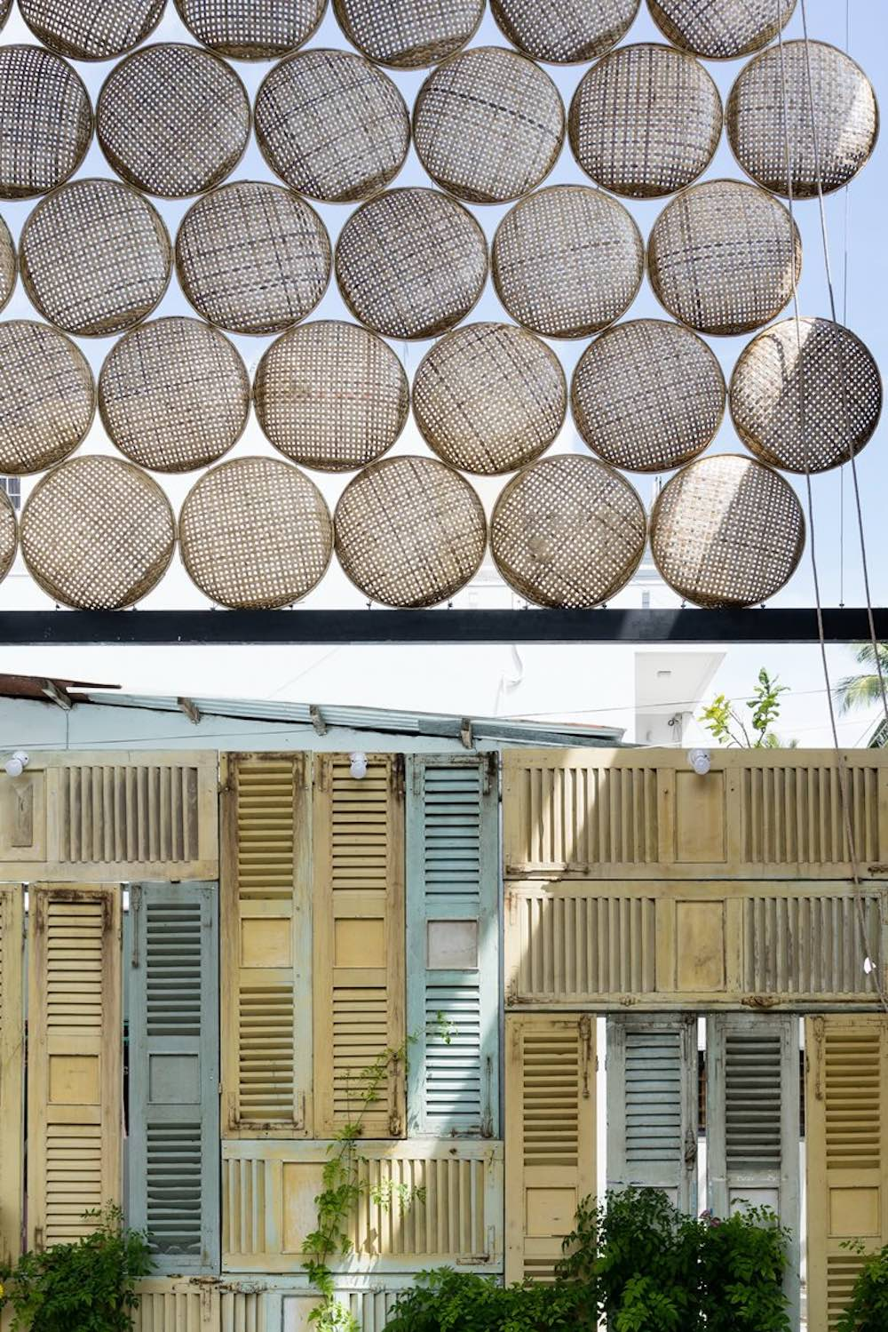 There are many interesting design elements worthy of mention, such as this wall made of lots of reclaimed shutters