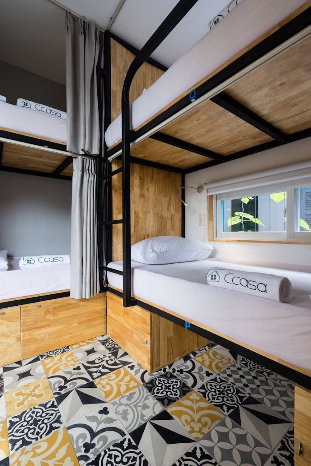 Each individual sleeping area has curtains for privacy and the idea of the bunk beds is to bring people together