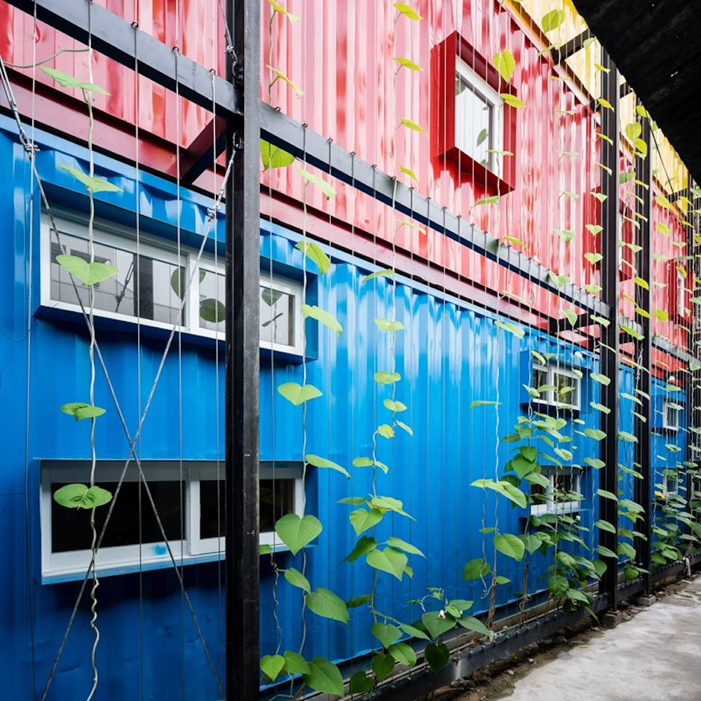 Each container has been painted in a bold color which contrasts with the other two