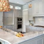 Gray kitchen with rattan lighting fixtures