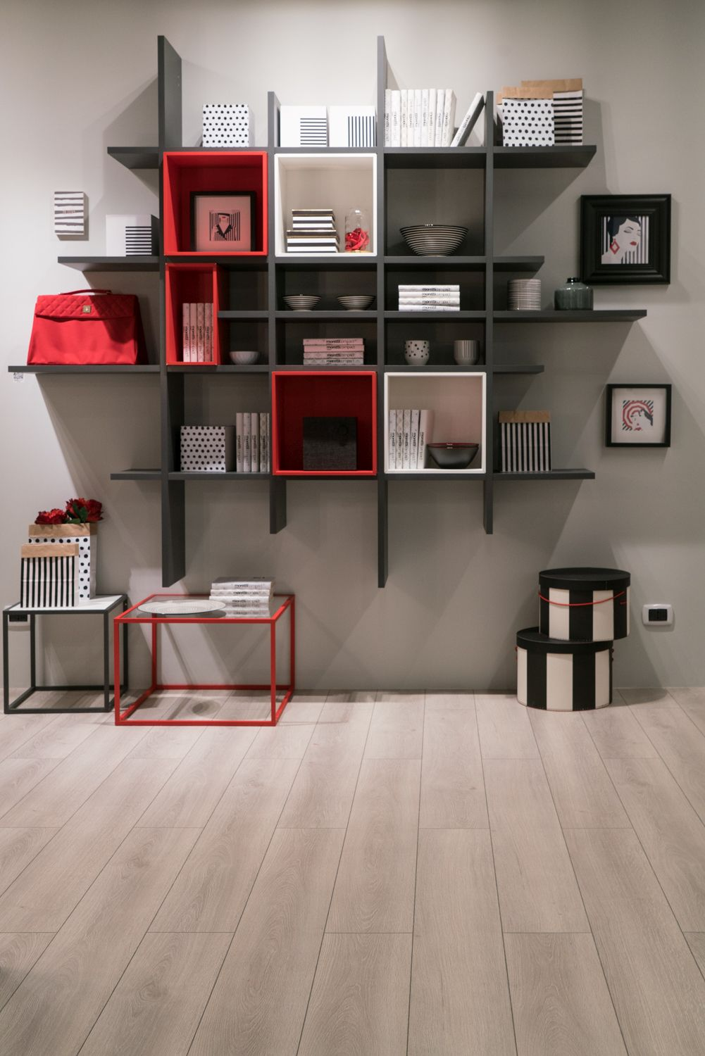 This is a very interesting and eye-catching shelving unit which combines several different colors and shapes