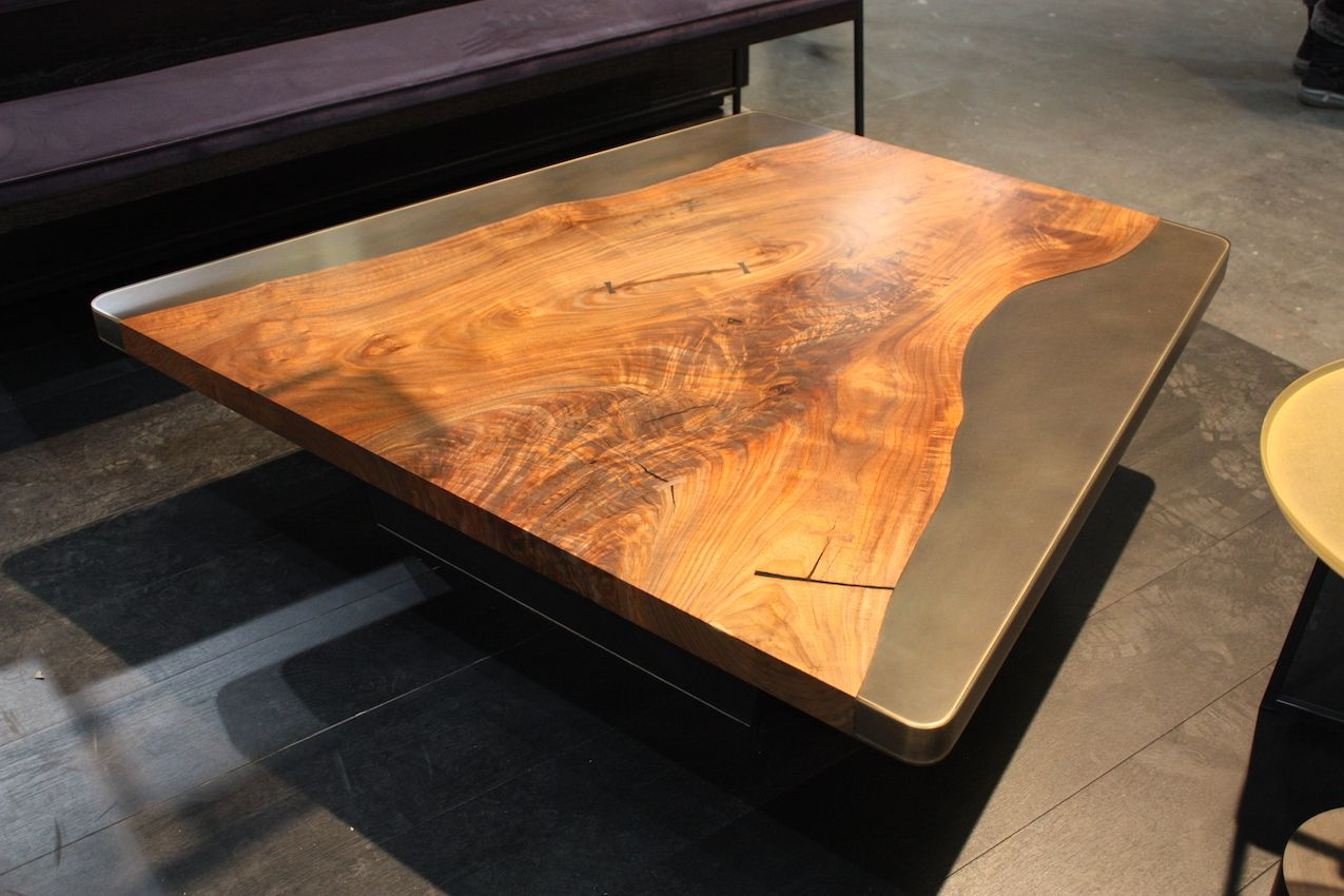Live-edge wood inset in resin creates a versatile, durable coffee table.