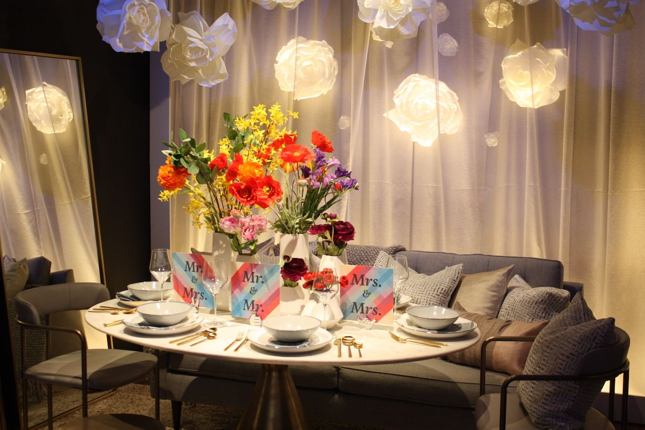 Lighted blooms behind sheer curtains add drama to a setting.