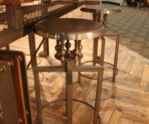 Unique stools add interest to the kitchen counter area.