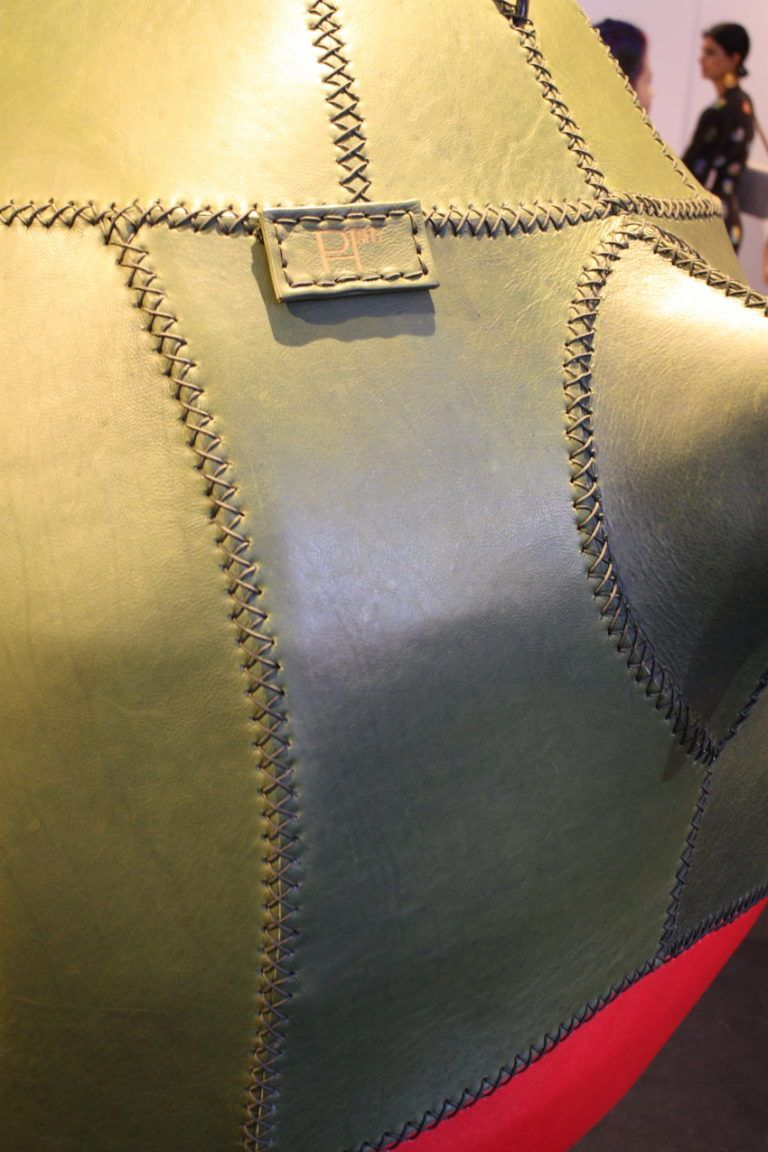 Stiches securing the leather pieces together are an important design detail.