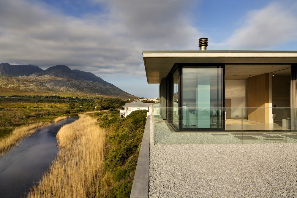 Being situated on the banks of a river, the house borrows calmness from its surroundings and also gets to frame some great views