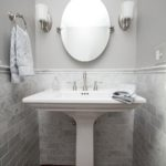 Small powder room with tile trim