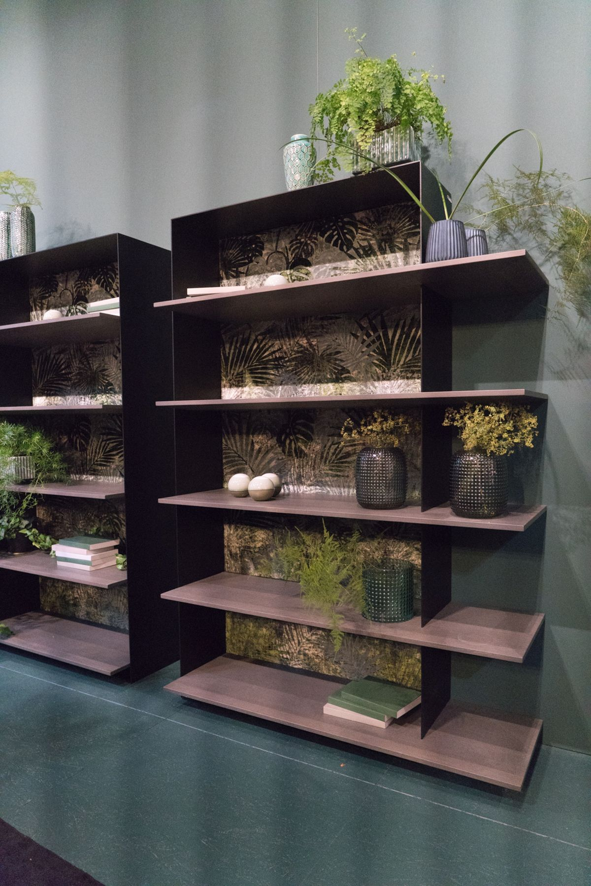 Shelving units can have an open back or a back panel which can have a special role in the decor of a space