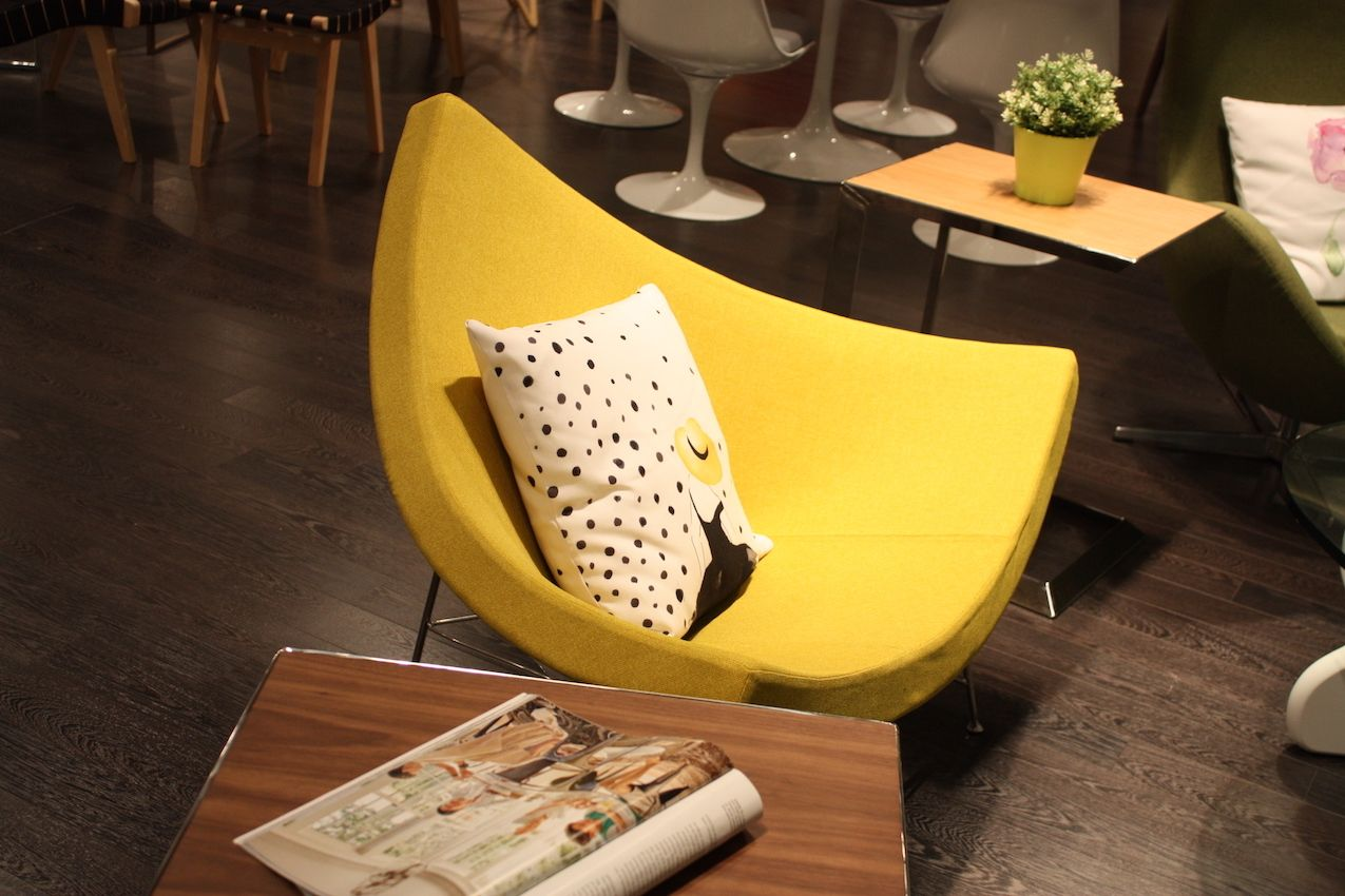 A bright yellow chair in a modern, distinctive shape is the perfect accent piece.