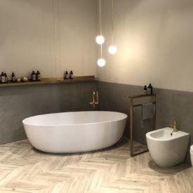 Bathroom decor with corner bathtub design