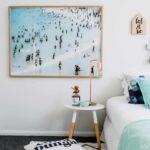 Beach bedroom with ocean art