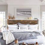 Beach bedroom with wood headboard