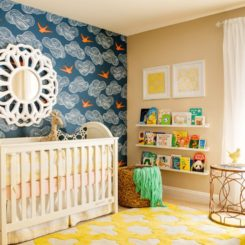 Colorful nursery room with wood ledge for books