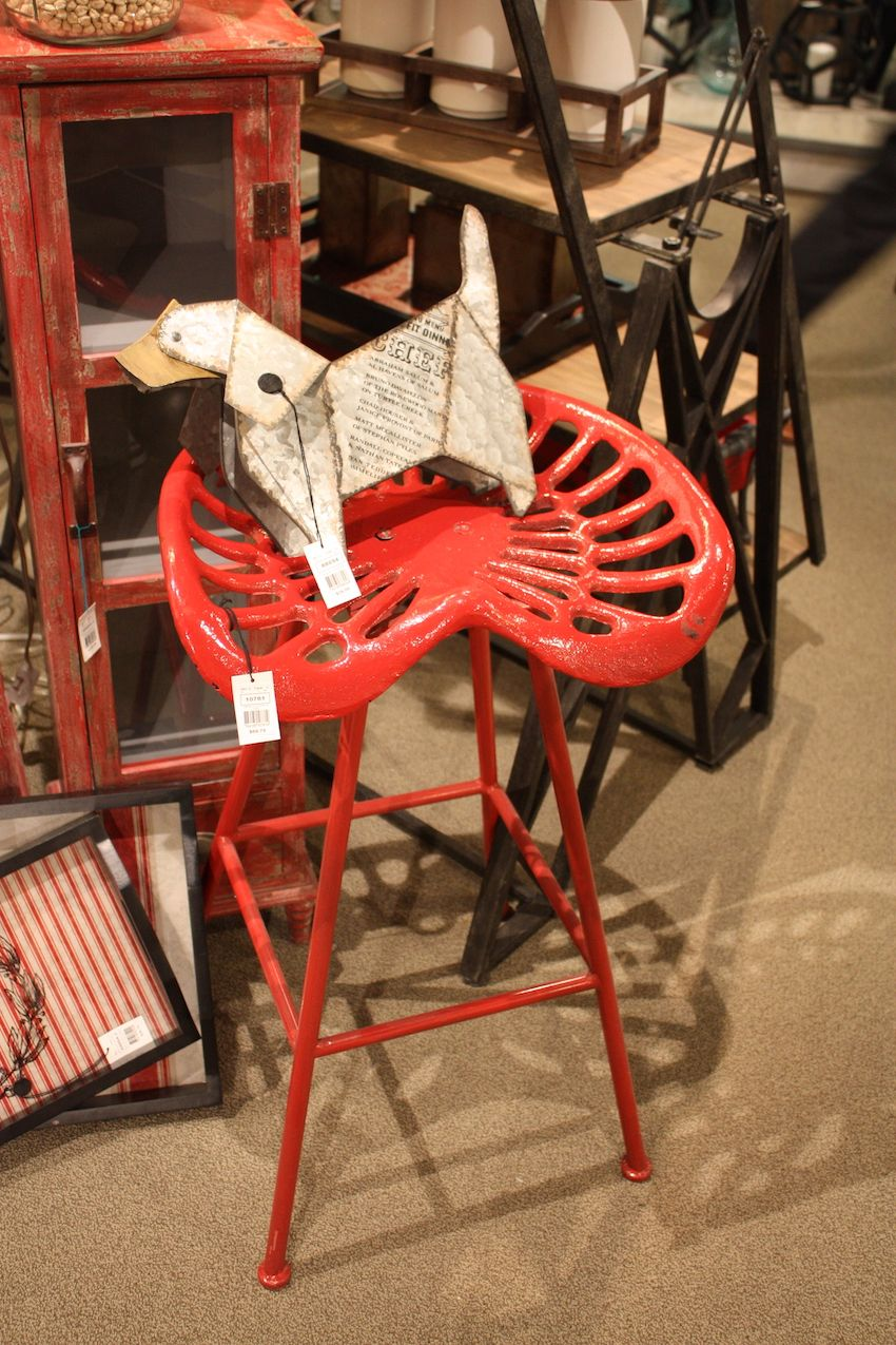 A tractor seat in bright red makes a whimsical stool.