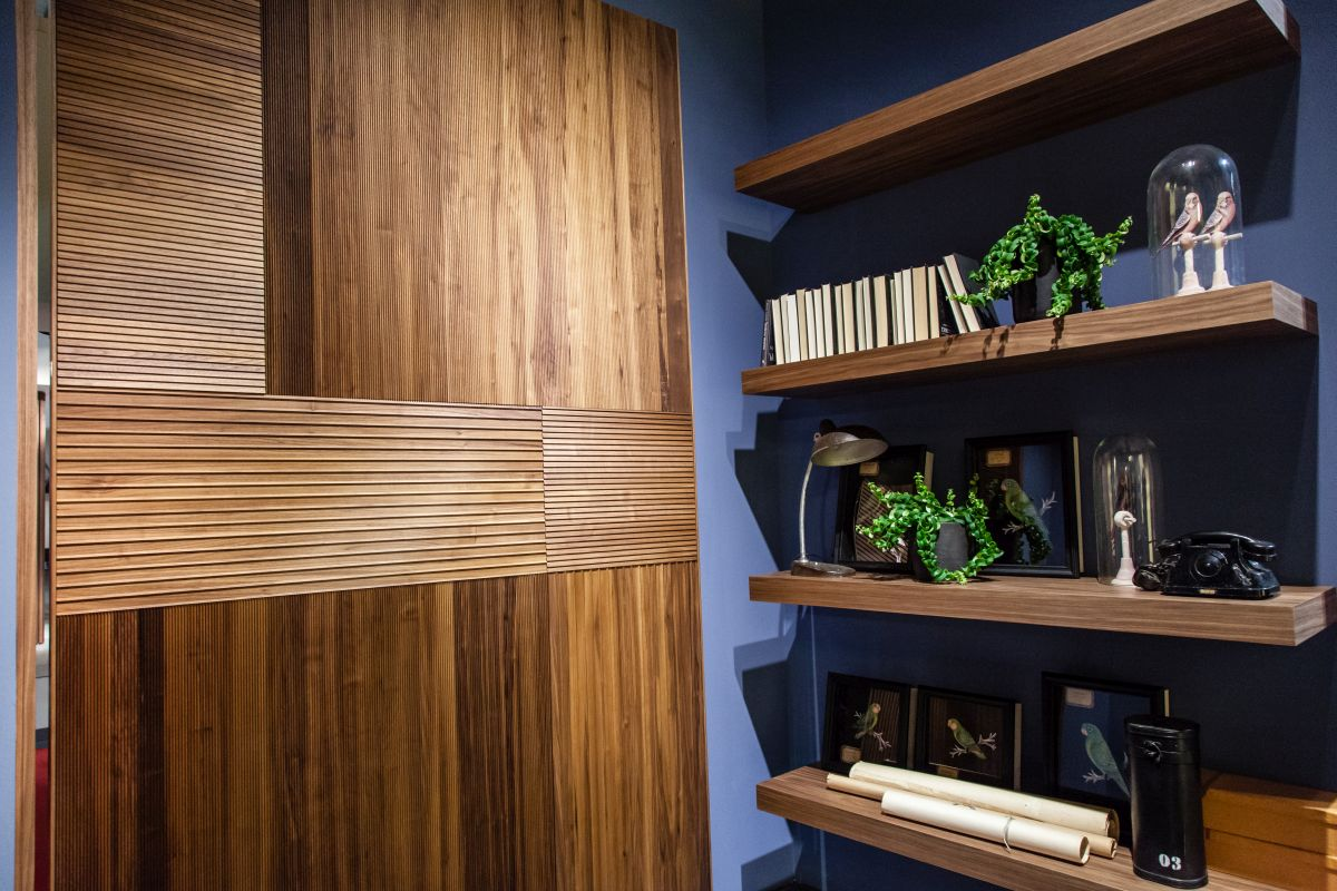 Wood paneling as an accent or door front is a modern usage.