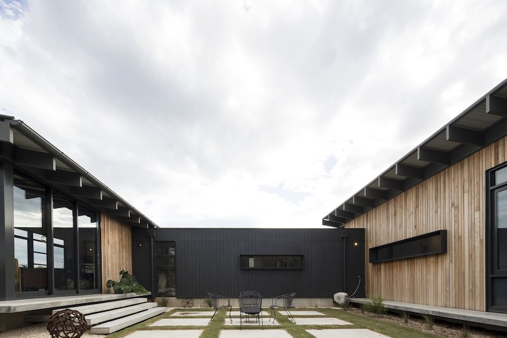 A central courtyard is formed between the different volumes of the house