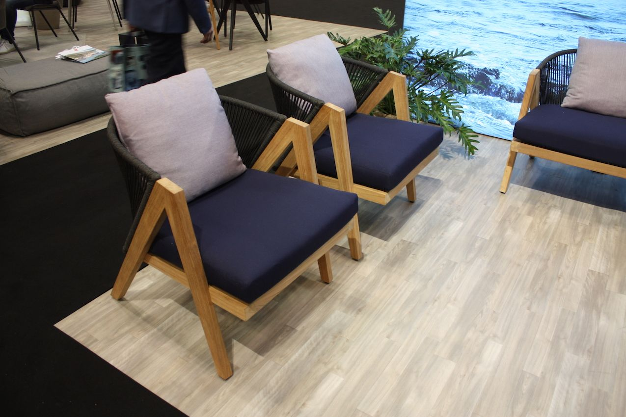 Wood is visually the dominant material in these Manutti chairs.